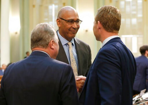 (AP Photo/Rich Pedroncelli). Assemblyman Chris Holden, D-Pasadena, center, shakes hands with Assemblyman Chad Mayes, R-Yucca Valley, after their wildfire measure they co-authored, along with Assemblywoman Autumn Burke, D-Inglewood was approved by the A...