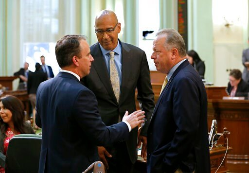 (AP Photo/Rich Pedroncelli). Assemblyman Marc Levine, D-San Rafael, left, talks with Assembly Chris Holden, D-Pasadena, center, after he cast one of the few dissenting votes on the wildfire measure co-authored by Holden, and carried in the Senate by st...