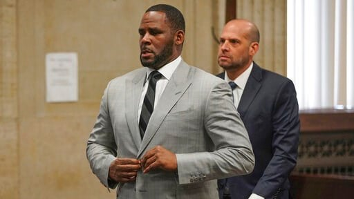 (E. Jason Wambsgans/Chicago Tribune via AP, Pool). FILE - In this  June 6, 2019, file photo, singer R. Kelly pleaded not guilty to 11 additional sex-related felonies during a court hearing before Judge Lawrence Flood at Leighton Criminal Court Building...