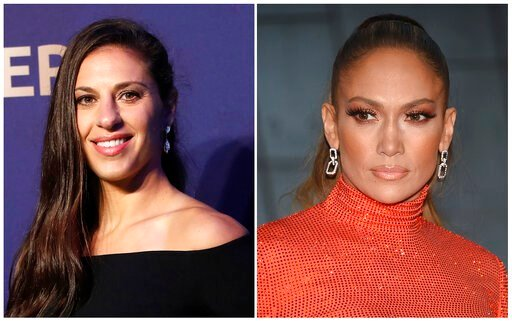 (AP Photo). In this combination of file photos Carli Lloyd smiles prior to the women's soccer World Cup France 2019 draw, in Boulogne-Billancourt, outside Paris, on Dec. 8, 2018 and Jennifer Lopez attends the CFDA Fashion Awards at the Brooklyn Museum ...