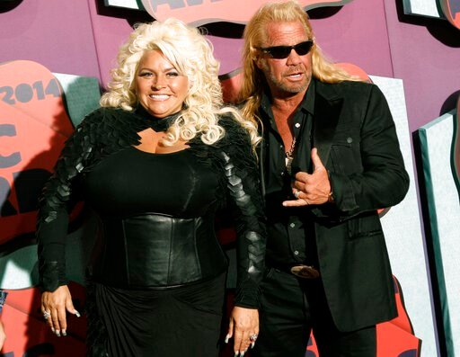 (Photo by Wade Payne/Invision/AP, File). FILE - In this June 4, 2014 file photo, Beth Chapman, left, and Duane Chapman arrive at the CMT Music Awards at Bridgestone Arena, in Nashville, Tenn. Funeral services for Beth Chapman, who starred with her husb...