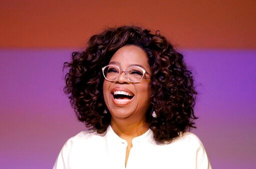 (AP Photo/Themba Hadebe, File). FILE - In this Nov. 29, 2018 file photo, Oprah Winfrey smiles during a tribute to Nelson Mandela and promoting gender equality event at University of Johannesburg in Soweto, South Africa.  Winfrey surprised the Maui Huma...