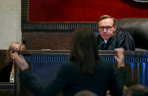 (AP Photo/Sue Ogrocki, Pool). Judge Thad Balkman listens to a defense attorney during the last day of testimony in Oklahoma's ongoing opioid drug lawsuit against Johnson & Johnson Friday, July 12, 2019, in Norman, Okla. Closing arguments are schedu...