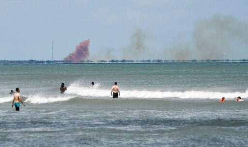 (Craig Bailey/Florida Today via AP, File). FILE - In this April 20, 2019, file photo, cloud of orange smoke rises over nearby Cape Canaveral Air Force Station, as seen from Cocoa Beach, Fla., after the SpaceX Dragon 2 capsule was destroyed during a tes...