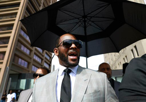 (AP Photo/Amr Alfiky, File). FILE  - In this June 6, 2019 file photo, musician R. Kelly departs the Leighton Criminal Court building after pleading not guilty to 11 additional sex-related charges in Chicago. A U.S. Attorney's office spokesman says Kell...