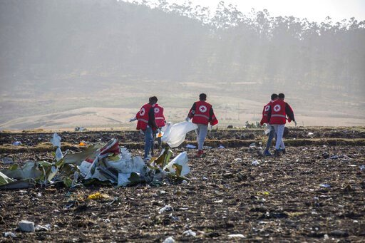 (AP Photo/Mulugeta Ayene). FILE - In this March 11, 2019, file photo, rescuers work at the scene of an Ethiopian Airlines flight crash near Bishoftu, or Debre Zeit, south of Addis Ababa, Ethiopia. Paul Njoroge, who lost his wife and three young childre...