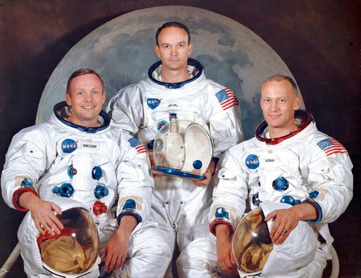 "(NASA via AP). This March 30, 1969 photo made available by NASA shows the crew of the Apollo 11, from left, Neil Armstrong, commander; Michael Collins, module pilot; Edwin E. ""Buzz"" Aldrin, lunar module pilot. Apollo 11 was the first manned mission to ..."