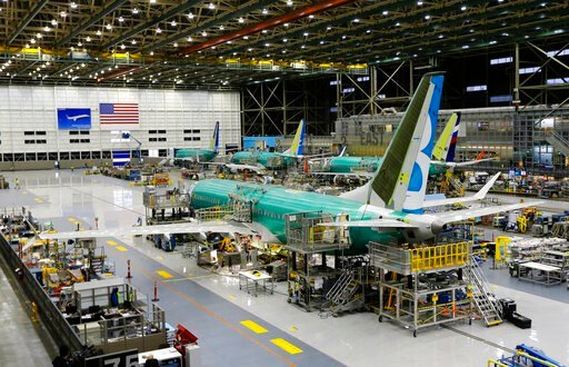 (AP Photo/Ted S. Warren, File). FILE - This Dec. 7, 2015, file photo shows the second Boeing 737 MAX airplane being built on the assembly line in Renton, Wash. American Airlines says it will keep the Boeing 737 Max plane off its schedule until Nov. 3, ...