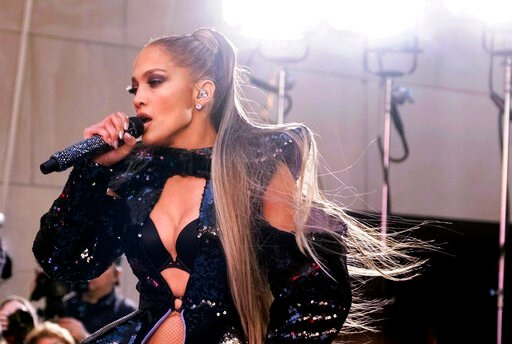 """(Photo by Charles Sykes/Invision/AP File). FILE - In this May 6, 2019 file photo, Jennifer Lopez performs on NBC's """"Today"""" show at Rockefeller Plaza in New York. Lopez kept her word to fans who were disappointed when a power outage in New York City for..."""
