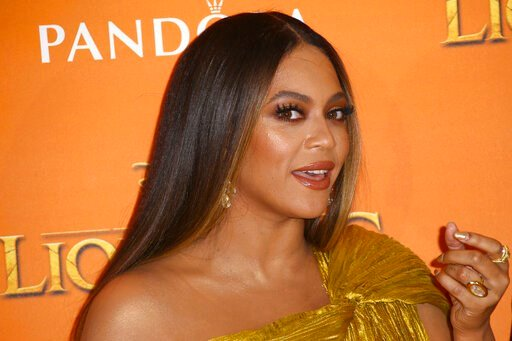 (Photo by Joel C Ryan/Invision/AP). Singer Beyonce poses for photographers upon arrival at the 'Lion King' European premiere in central London, Sunday, July 14, 2019.