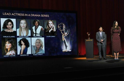 (Photo by Richard Shotwell/Invision/AP). Ken Jeong, left, and D'Arcy Carden announce the nominees for lead actress in a drama series at the 71st Primetime Emmy Nominations Announcements at the Television Academy's Saban Media Center on Tuesday, July 16...