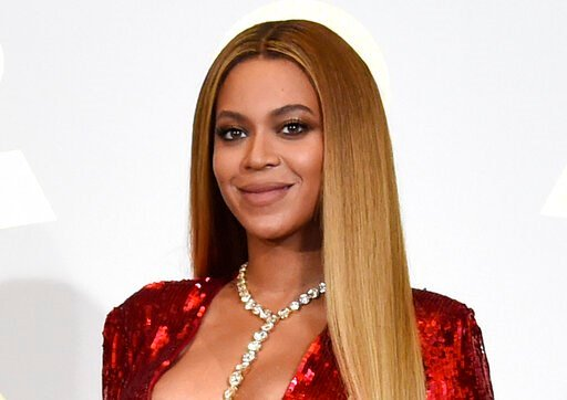 """(Photo by Chris Pizzello/Invision/AP, File). FILE - In this Feb. 12, 2017 file photo, Beyonce poses in the press room at the 59th annual Grammy Awards in Los Angeles. Beyonce is dropping a new original song from Disney's live-action """"Lion King."""" The so..."""