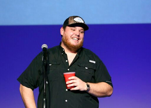 """(Photo by Al Wagner/Invision/AP). Luke Combs speaks at """"Luke Combs Joins the Grand Ole Opry Family,"""" at Grand Ole Opry, Tuesday, July 16, 2019, in Nashville, Tenn."""