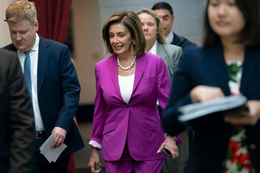 "(AP Photo/J. Scott Applewhite). House Speaker Nancy Pelosi, D-Calif., arrives for a closed-door session with her caucus before a vote on a resolution condemning what she called ""racist comments"" by President Donald Trump at the Capitol in Washington, T..."