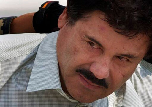 "(AP Photo/Eduardo Verdugo, File). FILE - In this Feb. 22, 2014, file photo, Joaquin ""El Chapo"" Guzman is escorted to a helicopter in handcuffs by Mexican navy marines at a navy hanger in Mexico City. Guzman, who was convicted in February 2019 on multip..."