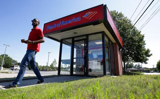 (AP Photo/Steven Senne). In this Monday, July 15, 2019 photo a customer departs a Bank of America ATM, in Norwood, Mass. Bank of America Corp. reports earnings Wednesday, July 17.