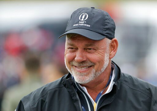 (AP Photo/Matt Dunham). Northern Ireland's Darren Clarke smiles as he speaks to colleagues don the practice range ahead of the start of the British Open golf championships at Royal Portrush in Northern Ireland, Wednesday, July 17, 2019. The British Ope...