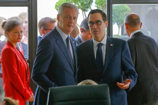 (AP Photo/Michel Euler). French Finance Minister Bruno Le Maire, left, talks to US Treasury Secretary Steve Mnuchin during a meeting at the G-7 Finance in Chantilly, north of Paris, on Thursday, July 18, 2019.