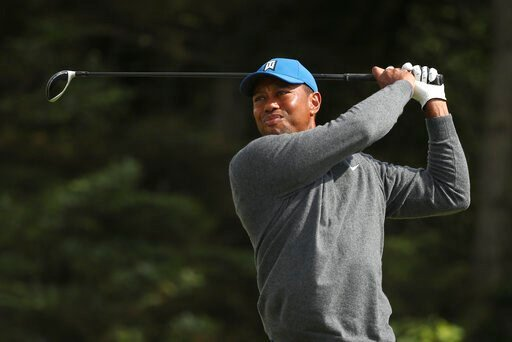 (AP Photo/Jon Super). Tiger Woods of the United States plays his tee shot on the 5th hole during the first round of the British Open Golf Championships at Royal Portrush in Northern Ireland, Thursday, July 18, 2019.