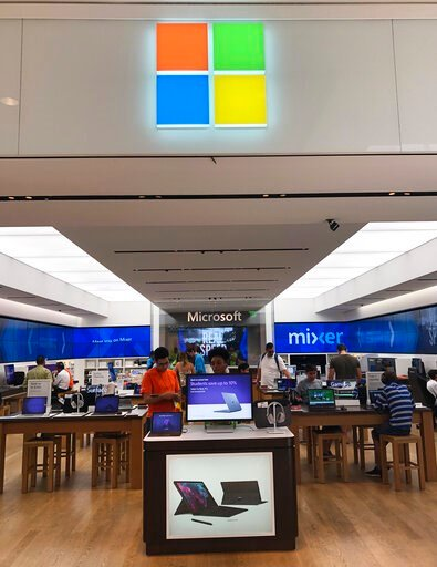 (AP Photo/Wilfredo Lee). In this July 11, 2019 photo, a Microsoft store is shown in Aventura, Fla. Microsoft Corp. reports earnings Thursday, July 18, 2019.