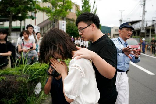 "(AP Photo/Jae C. Hong). A woman prays to honor the victims of Thursday's fire at the Kyoto Animation Studio building, Friday, July 19, 2019, in Kyoto, Japan. A man screaming ""You die!"" burst into the animation studio in Kyoto, doused it with a flammabl..."