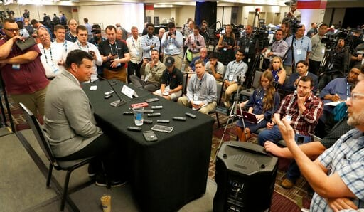(AP Photo/Charles Rex Arbogast). Ohio State head coach Ryan Day, left, talks to reporters during the Big Ten Conference NCAA college football media days Thursday, July 18, 2019, in Chicago.