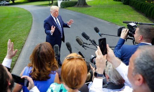 (AP Photo/Pablo Martinez Monsivais). President Donald Trump speaks to members of the media before boarding Marine One helicopter on the South Lawn of the White House in Washington, for the short flight to nearby Andrews Air Force Base, Md., Friday, Jul...