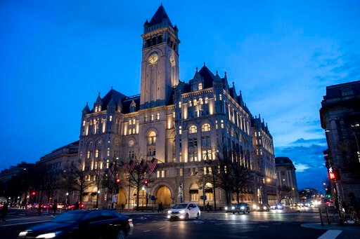(AP Photo/Alex Brandon, file). FILE - In this Jan. 23, 2019, file photo, the Trump International Hotel near sunset in Washington. The Justice Department is challenging a District of Columbia federal judge's decision allowing a case accusing President D...