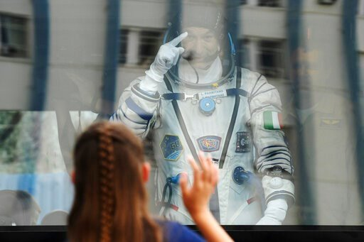 (AP Photo/, Pool). Italian astronaut Luca Parmitano, member of the main crew of the expedition to the International Space Station (ISS), gestures to his relatives from a bus prior the launch of Soyuz MS-13 space ship at the Russian leased Baikonur cosm...