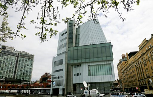 (AP Photo/Bebeto Matthews, File). FILE- This April 30, 2015 photo shows an exterior view of the Whitney Museum of American Art in New York. Seven artists have asked the museum to remove their work from its biennial showcase of American art over a museu...