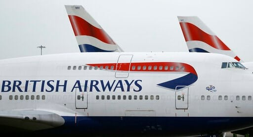 (AP Photo/Frank Augstein, File). FILE - This Jan. 10, 2017 file photo shows British Airways planes parked at Heathrow Airport in London. On Saturday, July 20, 2019, British Airways said it is canceling flights to Cairo for a week for unspecified securi...