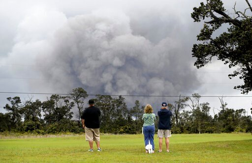 (AP Photo/Caleb Jones, File). FILE - In this May 17, 2018 file photo, people watch as ash and debris explode from the summit crater of Kilauea volcano in Volcano, Hawaii. A small pond of water has been discovered inside the summit crater of Kilauea vol...