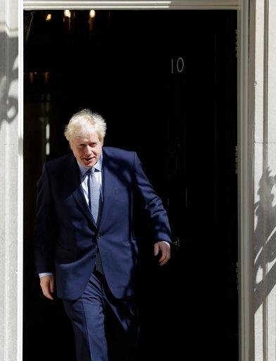 (AP Photo/Kirsty Wigglesworth). Britain's Prime Minister Boris Johnson emerges to welcome Prime Minister of Estonia Juri Ratas for a meeting at Downing Street in London, Tuesday, Aug. 6, 2019.