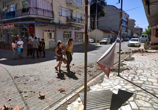 (Ramazan Cetin/DHA via AP). Minor damage, from an earthquake is seen on a street as residents stay out of buildings and on streets in Bozkurt, in Denizli province, west Turkey, Thursday, Aug. 8, 2019. The earthquake with an estimated magnitude of 6.0 h...