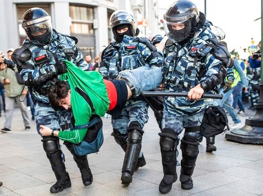 (Evgeny Feldman, Meduza via AP). Police detain a man during a protest in Moscow, Russia, Saturday, Aug. 10, 2019. Tens of thousands of people rallied Saturday against the exclusion of some city council candidates from Moscow's upcoming election, turnin...