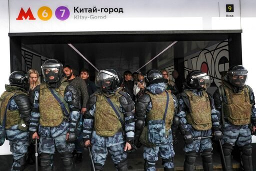 (AP Photo). Police block a subway entrance during a protest in Moscow, Russia, Saturday, Aug. 10, 2019.  Tens of thousands of people rallied in central Moscow for the third consecutive weekend to protest the exclusion of opposition and independent cand...
