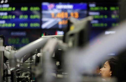(AP Photo/Lee Jin-man). A currency trader watches computer monitors at the foreign exchange dealing room in Seoul, South Korea, Tuesday, Aug. 13, 2019. Asian stock markets followed Wall Street lower Tuesday amid anxiety the U.S.-Chinese trade war will ...