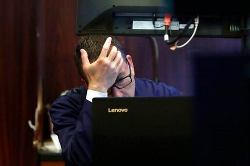 (AP Photo/Richard Drew). Trader David Fox works on the floor of the New York Stock Exchange, Monday, Aug. 12, 2019. Stocks are extending their losses at midday as investors opened the week heading for safety amid heightened anxiety over the U.S.-China ...
