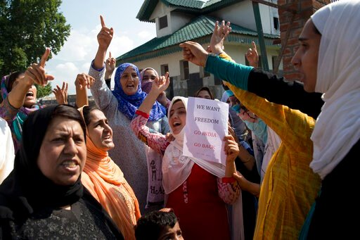 (AP Photo/ Dar Yasin). Kashmiri Muslim women shout slogans during a protest after Eid prayers in Srinagar, Indian controlled Kashmir, Monday, Aug. 12, 2019. Troops in India-administered Kashmir allowed some Muslims to walk to local mosques alone or in ...