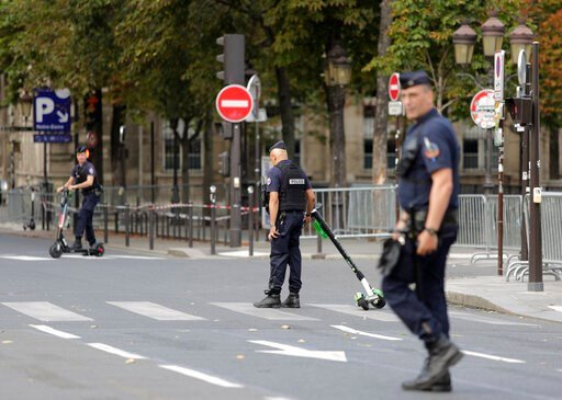 (AP Photo/Lewis Joly). Police officers remove electric scooters from the area around Notre Dame cathedral in Paris, Monday, Aug. 12, 2019. Authorities started clearing the area around Notre Dame ahead of decontamination and cleanup work which will resu...
