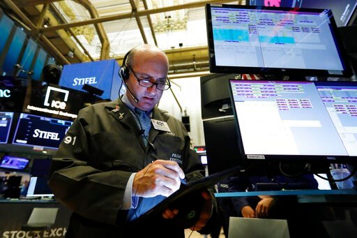 (AP Photo/Richard Drew, File). FILE - In this Aug. 6, 2019, file photo trader Andrew Silverman works on the floor of the New York Stock Exchange. The U.S. stock market opens at 9:30 a.m. EDT on Tuesday, Aug. 13.