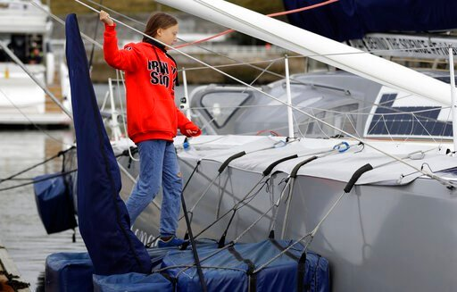 (AP Photo/Kirsty Wigglesworth). Greta Thunberg climbs onto the boat Malizia as it is moored in Plymouth, England Tuesday, Aug. 13, 2019. Greta Thunberg, the 16-year-old climate change activist who has inspired student protests around the world, is head...