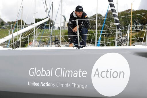 (AP Photo/Kirsty Wigglesworth). Skipper Boris Herrmann works on the boat Malizia as it is moored in Plymouth, England Tuesday, Aug. 13, 2019. Greta Thunberg, the 16-year-old climate change activist who has inspired student protests around the world, is...
