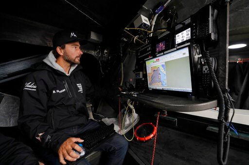 (AP Photo/Kirsty Wigglesworth). Skipper Boris Herrmann works below deck in the navigation area on the boat Malizia as it is moored in Plymouth, England Tuesday, Aug. 13, 2019. Greta Thunberg, the 16-year-old climate change activist who has inspired stu...