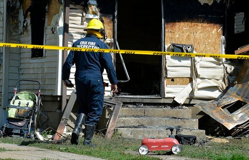 (Greg Wohlford/Erie Times-News via AP). Erie Bureau of Fire Inspector Mark Polanski helps investigate a fatal fire at 1248 West 11th St. in Erie, Pa, on Sunday, Aug. 11, 2019. Authorities say an early morning fire in northwestern Pennsylvania claimed t...