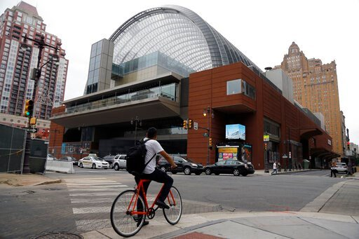 (AP Photo/Matt Slocum). A cyclist passes by The Kimmel Center for the Performance Arts, Tuesday, Aug. 13, 2019, in Philadelphia. On Tuesday, the Philadelphia Orchestra rescinded an invitation for Placido Domingo appear at its opening night concert in S...