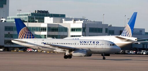 (AP Photo/David Zalubowski, File). FILE - In this June 26, 2019, file photo United Airlines jetliners pass each other at Denver International Airport in Denver. United Airlines is setting an earlier cut-off time when pilots must stop drinking alcohol b...