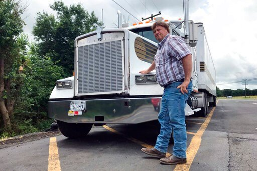 (AP Photo/Tom Sampson). In this June 13, 2019 photo, truck driver Terry Button poses with his truck during at stop in Opal, Va., Thursday, June 13, 2019. The Trump administration has moved a step closer to relaxing federal regulations governing the amo...
