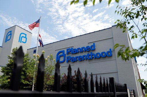 (AP Photo/Jeff Roberson, File). FILE- In this June 4, 2019, file photo, a Planned Parenthood clinic is photographed in St. Louis. Planned Parenthood says it will leave the federal family planning program by Monday, Aug. 19, unless a court puts a hold o...