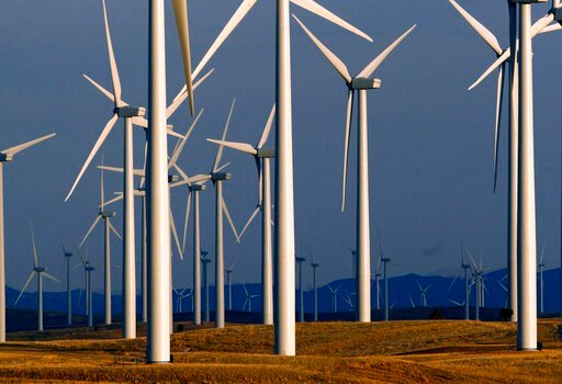 (AP Photo/Matt Young). FILE - This May 6, 2013 file photo shows a wind turbine farm owned by PacifiCorp near Glenrock, Wyo. Bigger, more efficient equipment will allow a western U.S. electric utility to redevelop an aging Wyoming wind farm with far few...